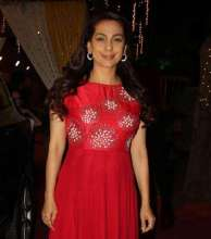 Actress Juhi Chawla in earrings by Yoube Jewellery for a music launch